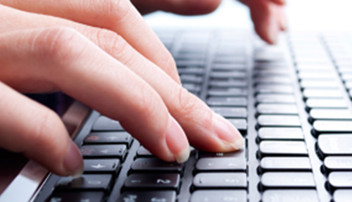 A live chat agent typing.